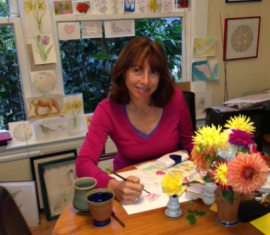 Diane Dulken in studio painting watercolor greeting cards