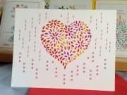 Cascading letters surrounding a vibrant heart. A wonderful way to say I love you for Valentine's Day and every day